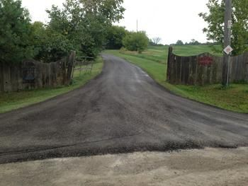 how to stop dust on gravel driveway